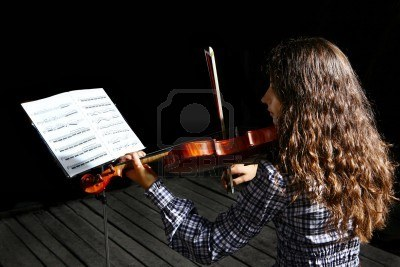 6467331-beautiful-violinist-musician-with-sheet-music-on-a-stand-on-black-background